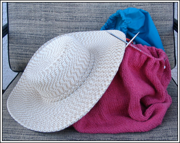 Sun_hat_and_coral_sweater